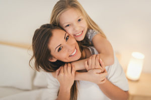 mother and daughter receive family and cosmetic dentistry