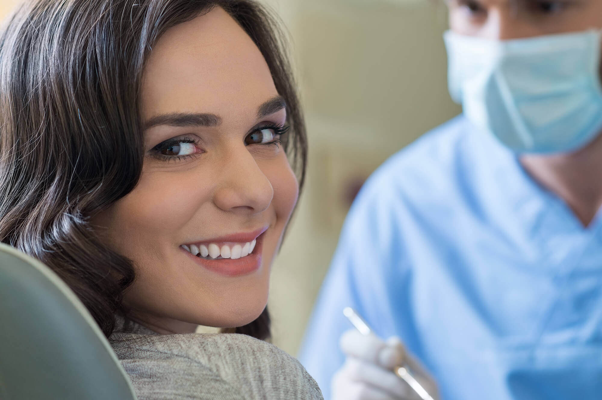woman smiling at camera receives new patient information