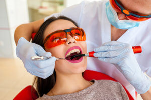 This woman could answer no to the question do tooth extractions hurt
