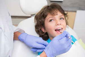 Kid in dentist chair during National children's Dental Health Month